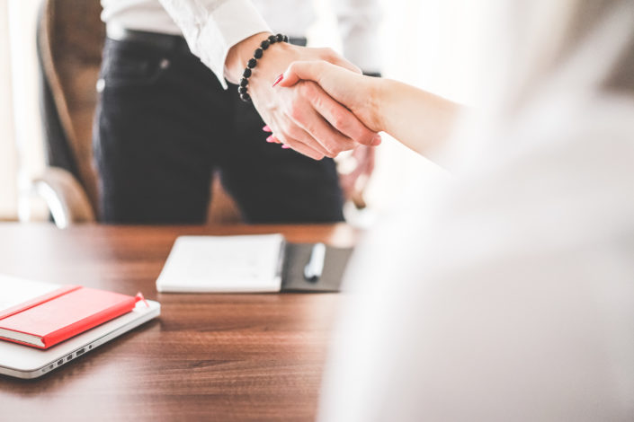 business man and woman handshake in work office picjumbo com